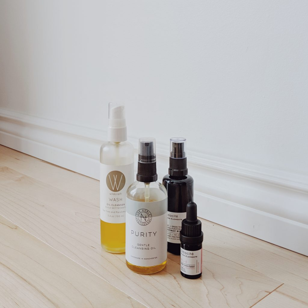 A set of natural skincare products, including oil cleanser, facial spray and serum