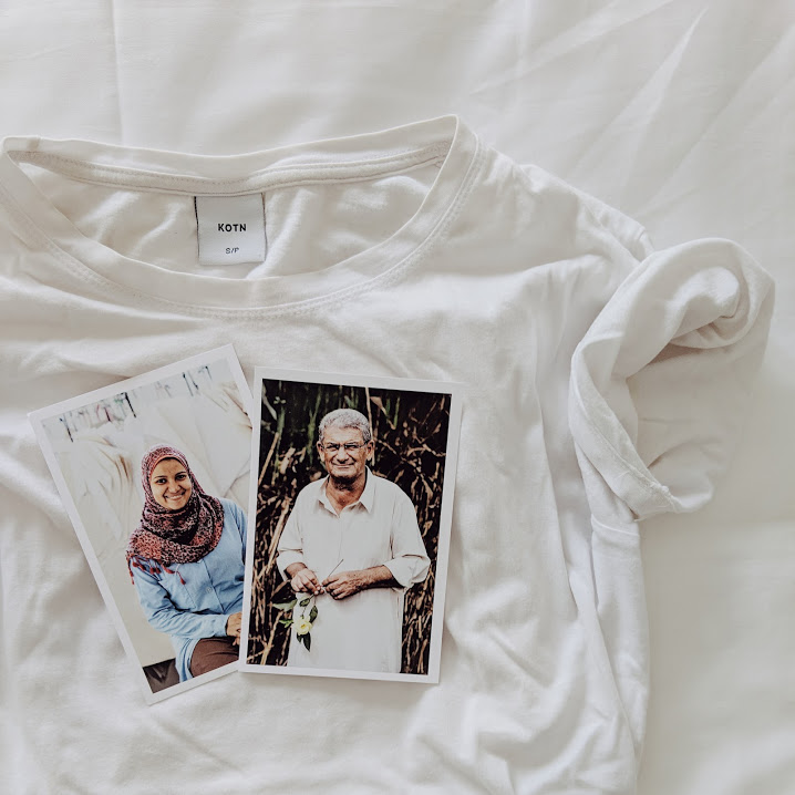 White Kotn t-shirt with two photos laying on top, of cotton farmers