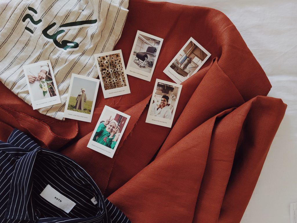 Polaroids of Kotn's manufacturing process laid on rust-coloured fabric