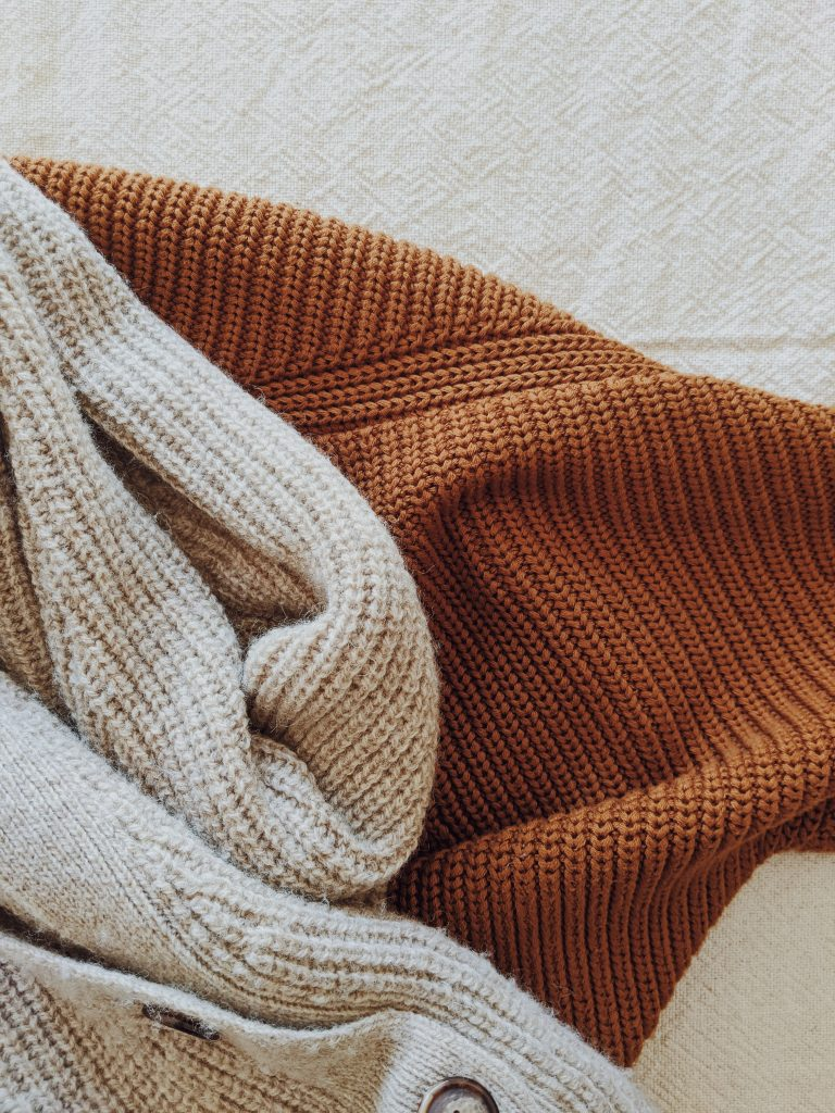 close-up photo showing the knit of both cardigans, with some minor pills on the L'Envers one