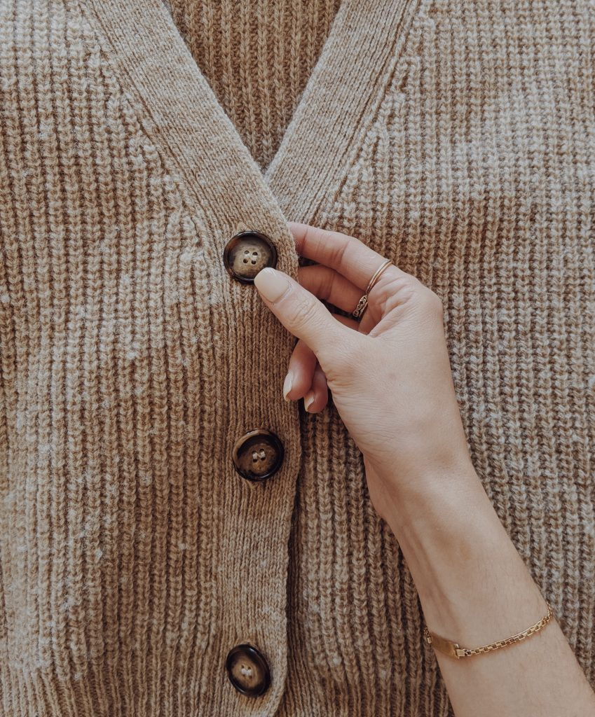 close-up showing the horn buttons of the L'Envers cardigan
