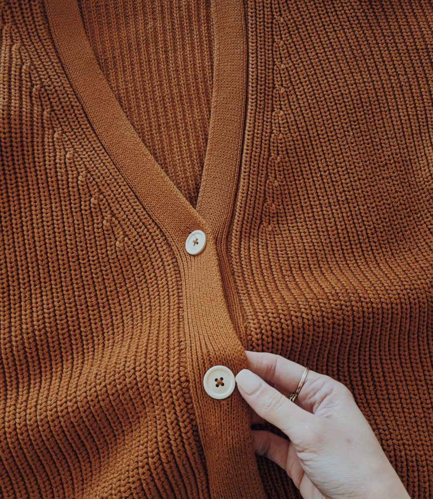 close-up showing the cream buttons of the Tradlands cardigan
